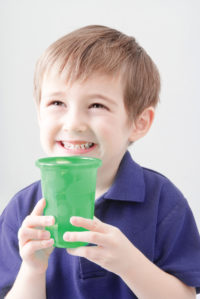 Integrity Water Solutions | Boy Drinking from Green Glass